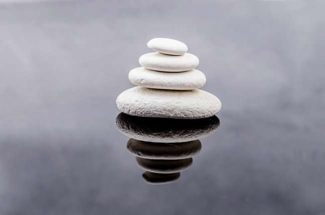 Pile of stones in pool of water