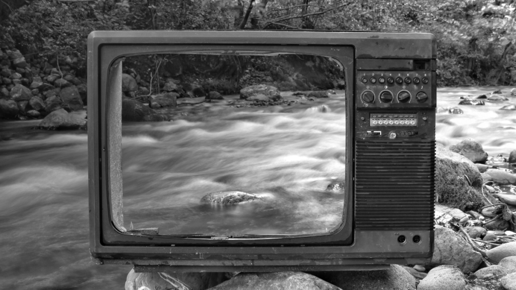 Dramatic empty TV with river rushing behind it