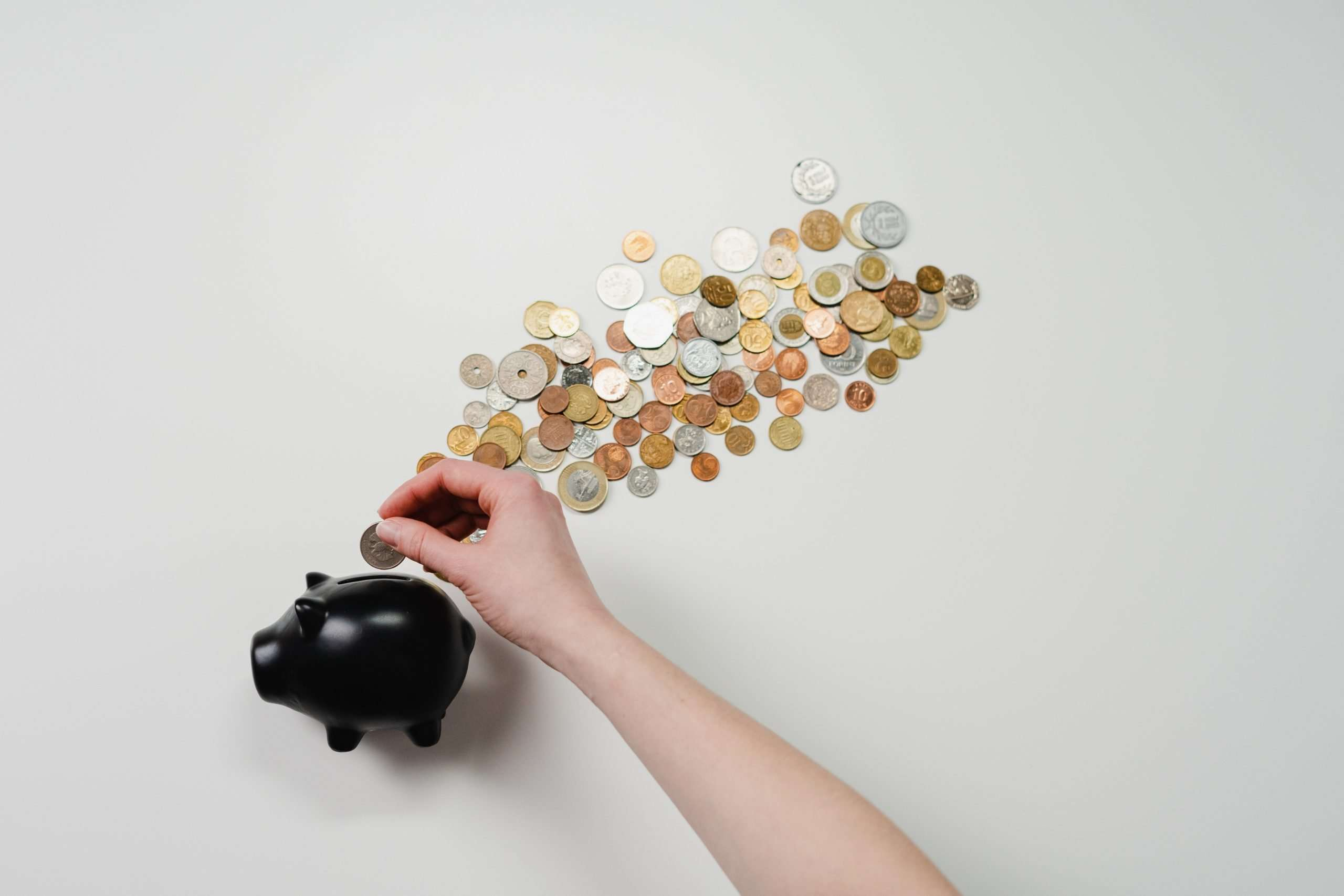 Change being put into a piggy bank